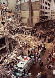 AP Photo: Firefighters and rescue workers search through the rubble of the Buenos Aires Jewish Community center...