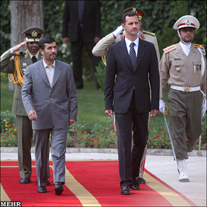 Iranian President Mahmoud Ahmadinejad (L) and his Syrian counterpart, Bashar al-Assad (R), review an honour guard during a welcoming ceremony for Assad in Tehran. Assad arrived in Tehran on Saturday for talks with staunch regional ally Iran that an official said would include the Islamic republic's controversial nuclear ambitions. (Reuters)