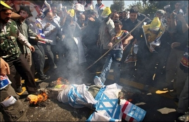 Iranian protestors burn an effigy draped in Israeli and US flags at a protest in October. Iran has invited Palestinian militant factions to a meeting in Tehran aimed at countering a US-sponsored Middle East peace conference seeking to kickstart the peace process. A government spokesmen says the 'alternative' conference will take place within the next two weeks.(AFP/File/Atta Kenare)