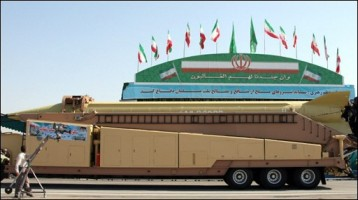 A military truck carries a long-range Iranian Shahab-3 missile during an annual military parade in Tehran. Iran also showed off a longer-range missile -- Ghadr-1 (Power) -- in public for the first time and proclaimed a string of anti-Israel slogans in a major military parade amid mounting tensions with the West.