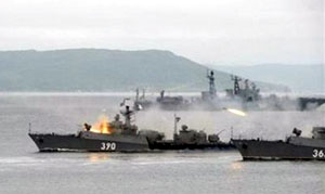Russian warships open fire during a presentation during Navy Day celebrations off the coast of the far eastern city of Vladivostok on July 29. Yuri Maltsev/Reuters
