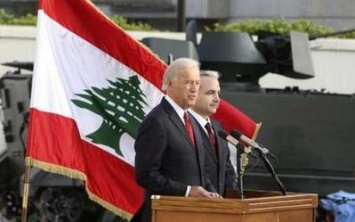U.S. Vice President Joe Biden (L) speaks during a joint news conference with Lebanon's Defence Minister Elias al-Murr during a ceremony reviewing U.S. military weapons donated to the Lebanese army at Beirut international airport May 22, 2009. Biden said on Friday Washington would assess its aid to Lebanon depending on who won next month's election, but denied taking sides in a vote pitching a Western-backed coalition against Hezbollah. REUTERS/Mohamed Azakir (LEBANON MILITARY POLITICS)