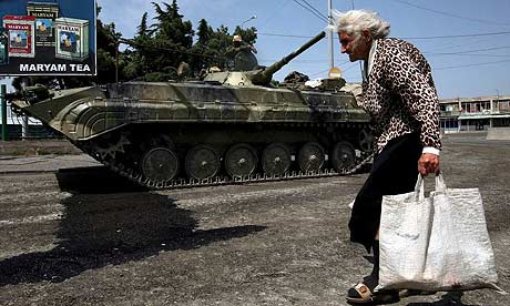 A woman passes a Russian armoured vehicle in Gori, Georgia. Photograph: Pavel Wolberg/EPA