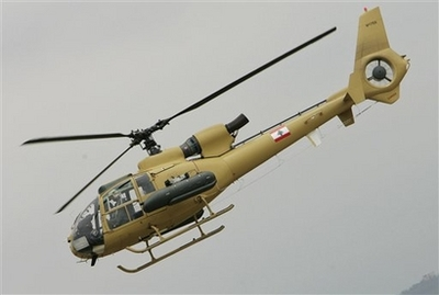 In this June 2, 2007 file photo, a Lebanese army helicopter (French-made Gazelle helicopter), is seen, strafed suspected positions in the first air force involvement in nearly two weeks of fighting at the sea side of the Palestinian refugee camp of Nahr el-Bared, with fighters from the Fatah Islam militant group, in the northern city of Tripoli. The Lebanese army says two pilots have been wounded when a military helicopter made an emergency landing in eastern Lebanon, on Friday June 20, 2008, after encountering a technical fault. The army command said in a statement that the French-made Gazelle helicopter was on a training flight Friday when it was forced to land near the eastern city of Baalbek in the Bekaa Valley after encountering a technical fault. (AP Photo/Hussein Malla,File)