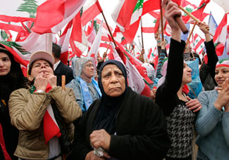 Government supporters gathered in Beirut Feb. 14, 2008, to mark the third anniversary of Rafik Hariri's assassination. Syria is the chief suspect in the murder of Mr. Hariri, but the investigation may cause setbacks in peace overtures initiated by Syria. Tara Todras-Whitehill/AP 